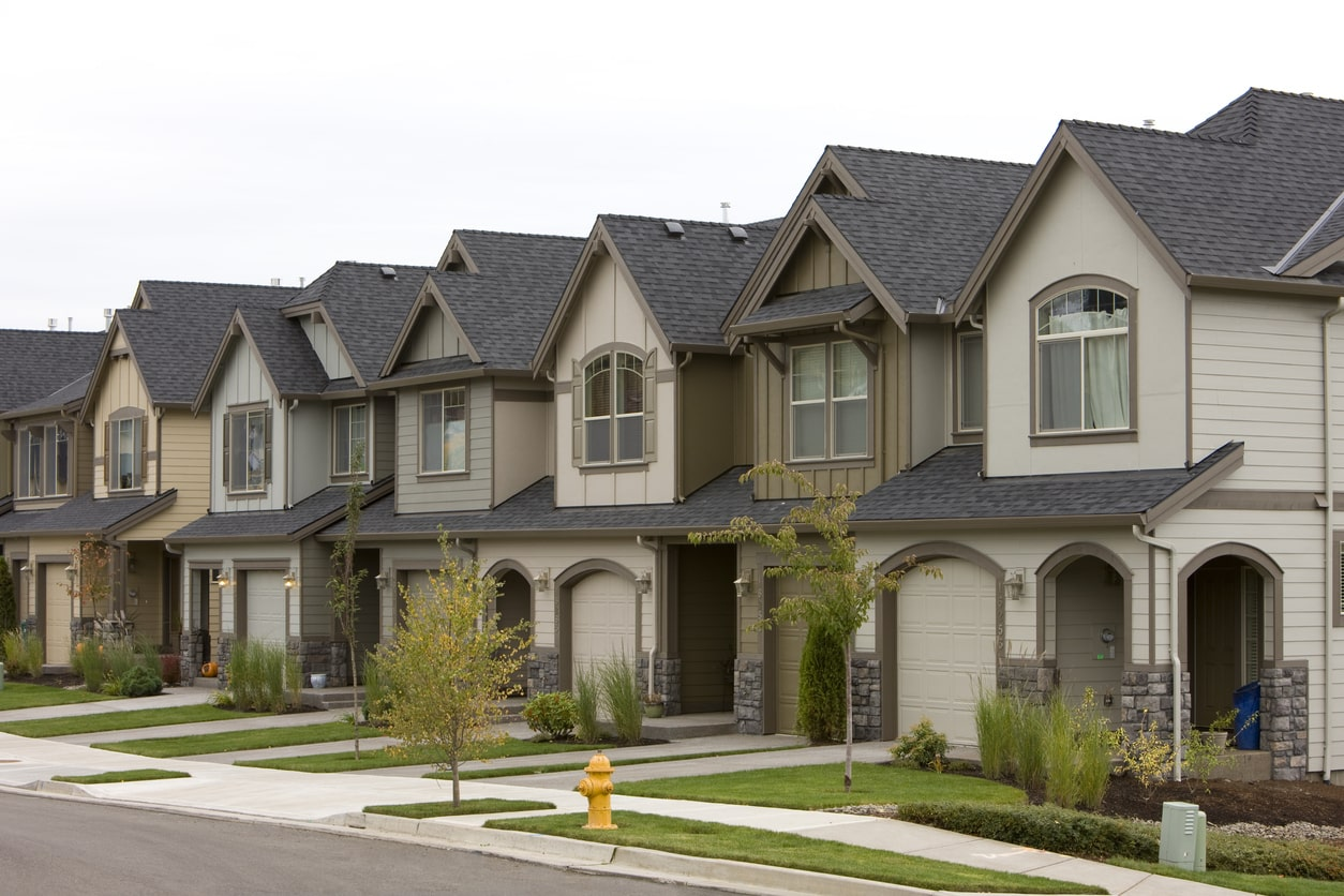 A row of white and grey townhomes that may benefit from property management services by San Diego Residential Property Management in San Diego